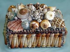 Seashell box. Ohhh I know what we are going to do. Just need to find a box and get a hot glue gun and some glue :-)
