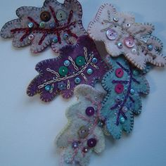 heres one I made earlier: New Felt Leaf Brooches
