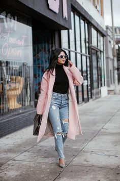 The Action - The movement of the woman in this photograph captures the lapels of this soft pink coat.