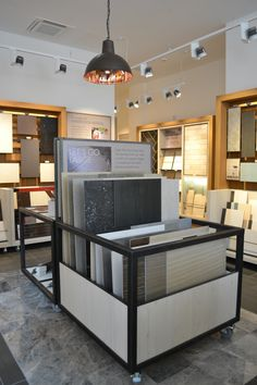 Boutique Tile Showroom for national tile retailer with bespoke display units both fixed and freestanding/ movable units designed in house by je+1.  #tiledisplay #retaildesign #retaildesigners #retaildisplay