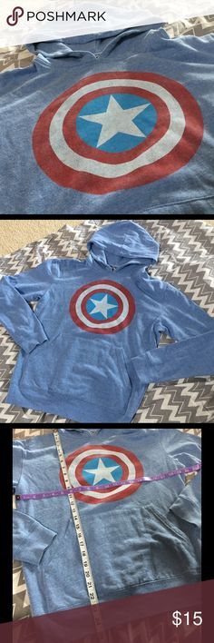 "Captain America SHIELD Hoody Sweater Used Captain America ""Shield"" hoody sweater with kangaroo pockets. Back has no design. Please refer to photo with measurements for sizing. Very soft and light weight, oversized fit. Live in Hawaii and have too many cute sweaters I cannot use 😪  🔺Slight pelting 🔴No trades. Please consider bundling with other items to save on shipping ❌I do not respond to unreasonable offers ✅POSH transactions only. 2761 Sweaters"