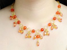 an Orange Bead Cluster Necklace with Golden Chain