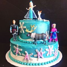 Frozen themed cake with Elsa, Anna, Olaf, and all their frozen buddies!