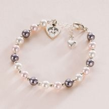 """Footprints Memorial Bracelet. Presented on the """"Thinking of You"""" card Thinking of You Gift. Pearl & Sterling Silver Fooprints on Your Heart Bracelet. Features a beautiful Sterling silver Footprints on heart charm and genuine Swarovski pastel pearls in pale pink, white and mauve."""