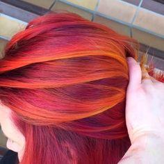 "One of favorite combinations using @pravana vivids neon orange yellow, orange, magenta,red, wild orchid with my #hairbestie @erinyuenphotography song by @mariahcarey ""you're mine"""