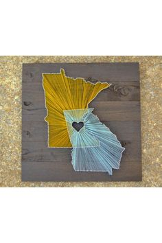 Two State String Art on a 21x21 piece of stained wood board. Represent two of your favorite cities by a piece of art to hang in your home. And