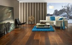The striking shade and character of our Oak Garrison timber flooring from the Havwoods Venture Plank range adds a dramatic flair to any space - from contemporary to traditional décor. The beautiful, emotive painting is by UK artist Ben Lowe. Flooring, Traditional Decor, Real Wood, Wood, Real Wood Floors, Timber, Residential, Engineered Wood Floors, Home Decor