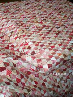 very similar to the triangle, scrap quilt I'm working on (and might finish in the next decade)