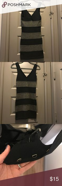 Sparkling Bodycon Striped black and gold bodycon. There are hooks in the back to add a ribbon detail (shown in last picture), but I opted to wear without and no longer have the string- you can't see the hooks while wearing. Great for New Years! Forever 21 Dresses Mini