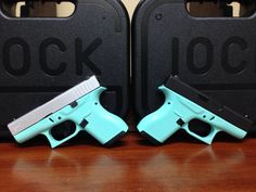 A pair of Glock 42 380's. Cerakote finish in custom mix Tiffany blue and Satin Silver