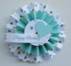 Paper rosette tutorial - nice idea to use border punch to make the finished result a little more decorative