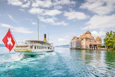 Best Castles in Europe - Scenic panorama view of traditional paddle steamer excursion ship with historic Chateau de Chillon at famous Lake Geneva Copyright Canadastock - European Best Destinations