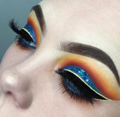 Yellow Orange Blue Eyeshadow | Black And Yellow Winged Liner | Cut crease Eye look | Bold Eye Look | Blue Glitter #eyemakeup #bold #liner Pin: @amerishabeauty
