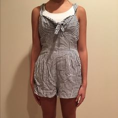 Striped White, Black, and Gray Forever 21 Romper Forever 21 gray, black, and white striped romper with a small keyhole and decorative knot in front below neckline. Zipper running down side. Thick tank top sleeves. Pockets. Shorts hit three quarters way up thigh. Worn once. Mint condition. Original price unknown. Offers encouraged, minimum price $10. Model height: 5 feet, 6 inches. One small sell can make one big difference! :-) Check out our profile and read about our cause! :-) Forever 21…