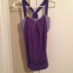 Lululemon rest less tank This super cute athletic top is in great condition! I don't even want to give it up but it is a bit too small for me. I'm pretty sure it is a size 4, which would be a small. It has a slightly flared bottom with a drawstring and a built in sports bra. lululemon athletica Tops Tank Tops