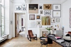 The Paris apartment of design dealers Laurence and Patrick Seguin features a wall of artworks by Richard Kern, David Noonan, Sam Durant, Carol Bove, and others. Pierre Jeanneret and Charlotte Perriand designed the desk and swivel chair, while the lounge chair is by Jean Prouvé.