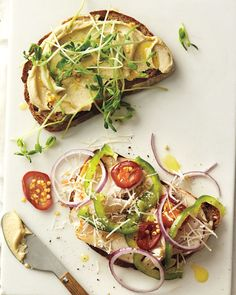 Ingredients        2 Tbsp hummus      2 slices whole-wheat bread      2 oz sliced turkey      1/4 green bell pepper, thinly sliced      1 pickled cherry pepper, sliced      2 Tbsp thinly sliced red onion      1 Tbsp grated Parmesan      1/4 cup pea shoots