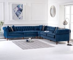 This chic and space-saving Lauren Blue Velvet Corner Sofa makes a stunning impression in any home Supported by resilient ornate solid wood feet