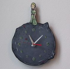 "Antoine de Saint-Exupéry's ""The Little Prince"" inspired this clock (By OffHerRockerArt on Etsy)"