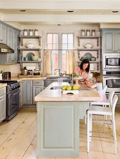 wouldn't this be a great look? Muted gray cabinetry with a distressed finish and open shelves reinforce the room's openness. The stainless steel appliances and sink add a sleek, metallic luster, and even the honed travertine marble countertops have lightness to them. On the walls and ceiling, boards are butted together for vintage cottage charm. (Photo: Laurey W. Glenn)