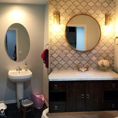 Bathroom powder room renovation before and after makeover. White Carrera Marble backsplash and countertop and round mirror. Gold and rustic brass accents. #PowderRoom #roundmirror #floatingvanity #beforeandafter #MarbleCountertops #renovations #WhiteandGold #bathroom #vanity #sconces