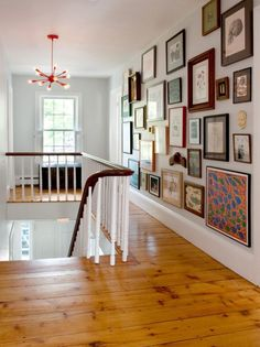 """Use an eclectic mix when filling a hallway wall. This collection is easier to """"see"""" than a wall of uniform shapes and matching frames"""