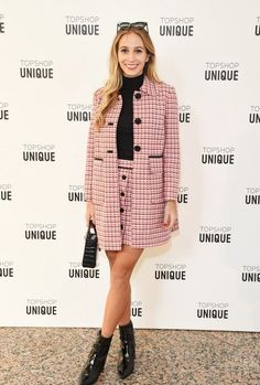 Harley Viera-Newton wears a turtleneck, '60s-inspired tweed coat, button-front tweed miniskirt, ankle boots, and a mini tote bag