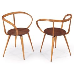 George Nelson Pretzel chairs by Herman Miller, 1958, molded birch plywood backrests, walnut seats [Treadway - Toomey Galleries]