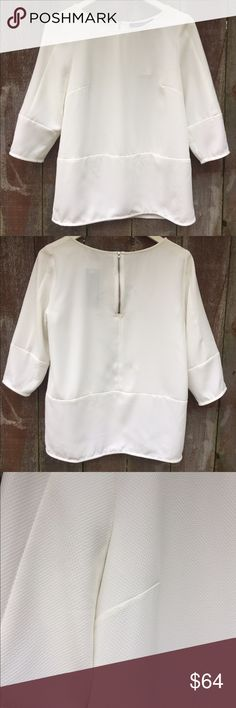 French Connection Sahara Textured Pullover Top 4 French Connection Sahara Textured Pullover Top NWT White Size 4, Retail price $128.   Easy fit with paneled detail through the body and at cuffs. Unlined with exposed back zipper detail. Textured woven fabric in 100% Poly, machine wash cold, dry inside out.   Thanks for looking and please browse my other great items! :) French Connection Tops Blouses
