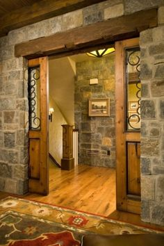 must have stone walls!!!! And I love the wood and scrolled metal pocket doors as well as the large wood beam above the door. by catrulz