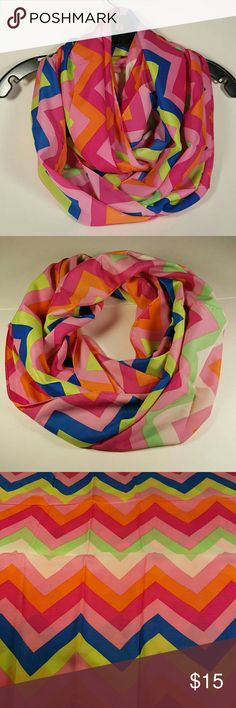 """Colorful Chevron Infinity Scarf Hi Poshers! I'm selling these cute Infinity scarves! The colors are blue, light pink, dark pink, green, orange and white! Measurements are 17.5""""H and 31""""W Oker Accessories Scarves & Wraps"""