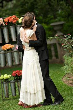 I love wedding photos where the couple is actually kissing!  -nice dress