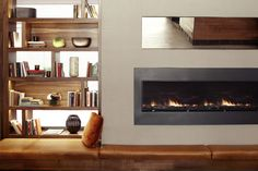 Residential style seating areas feature fireplaces, books shelves and comfortable lounge chairs and sofas.