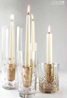 Make these beautiful candlestick holders with gold leaf and shot glasses.
