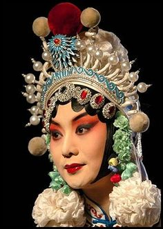 Chinese opera is a popular form of drama and musical theatre in China with roots going back as far as the third century CE. There are numerous regional branches of Chinese opera, of which the Beijing opera (Jingju) is one of the most notable. Chinese Traditional Costume, Traditional Art, Headdress, Headpiece, Chinese Opera Mask, Dragon Dance, Dragon Lady, China Art, We Are The World