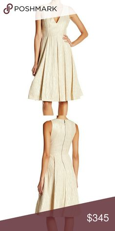 NWT, Alice + Olivia Mindee Dress Richly textured faux suede with subtle metallic highlights elevates this fit-and-flare dress while a plunging V-neckline bares an alluring bit of collarbone. Exposed back-zip closure. Sleeveless. Lined. 88% polyester, 12% elastane. Dry clean. BNWTA! Colors are gold and beige. Alice + Olivia Dresses