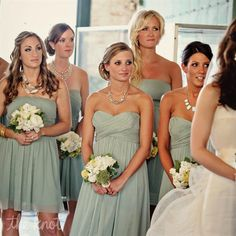 Love the white floweres with the sage green dresses