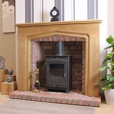 Love this idea to turn an old wood burning stove  in to s more traditional fireplace  :)  -db.