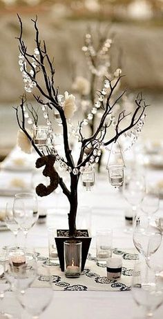 Wedding Reception table centrepieces. Manzanita tree with hanging crystals 3 ft tall. Alec and I are in love with them!