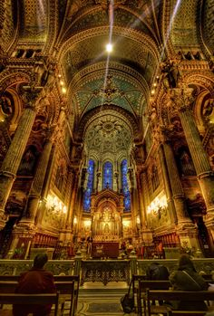 The interior of the Notre Dame was vast, golden, and could not possibly fit through the eye of a needle.