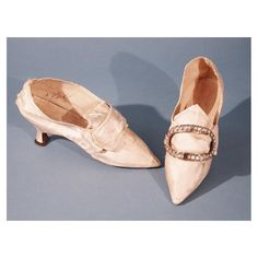 Woman's Shoes about 1775-1785 Hand-stitched silk satin with covered wooden heel and leather sole, with a metal and glass buckle