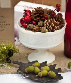 the perfect centerpiece from a Rustic Woodland Inspired Holiday Shoot with berries, acorns and pine cones