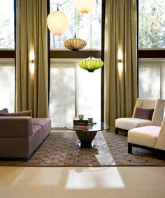 A fun light fixture grouping.  A great way to take advantage of the verticle space.