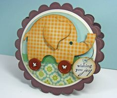 "I love the idea of using my favorite elephant image & adding button wheels!! I love the elephant from my ""Martha Stewart Birthday Cake Art"" & I could use the scalloped card from ""Wild Card"""