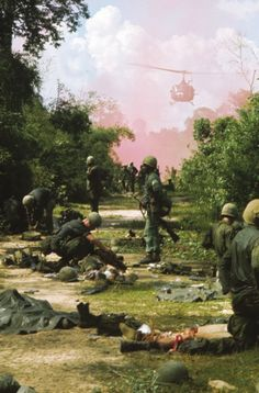 Vietnam 1965. An american medical helicopter emerges through a pink cloud to evacuate wounded survivors of the 173rd Airborn Regiment ambushed in War Zone C.