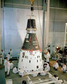 Gemini 11 maintenance  (July 21, 1966) The Gemini 11 spacecraft is lowered onto a dolly for preflight maintenance before stacking on the Titan rocket at the Kennedy Space Center. Dick Gordon and Pete Conrad would liftoff in this spacecraft on September 12, 1966 for a mission lasting almost three days. The crew practiced docking with the Agena unmanned docking craft, and Gordon also performed two spacewalks during the mission.