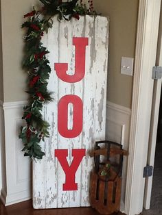 Pottery Barn knock-off! Pallet wood (free), white chalk paint (find a DIY chalk paint recipe. It's cheap to make with $3 paint samples from Home Depot) and either vinyls letters or stencil them on and paint with a little red acrylic paint ($1 a bottle at hobby lobby)