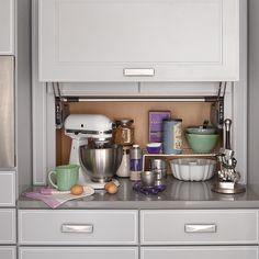 Free up counter space by storing your mixer, toaster, coffeemaker, or other small appliances in a built-in garage. This one has a lift-up door for easy access.