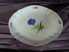 Here is a one of a kind shallow oval bowl from Meissen. It is exquisite. Early 1900s. Gorgeous large blue and yellow flower with small flowers around the rim. Stunning condition with little usage, just minor wear to the gilt trim. | eBay!
