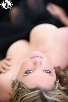 An upside-down pose can really show off your gorgeous face. | 33 Impossibly Sexy Boudoir Photo Poses